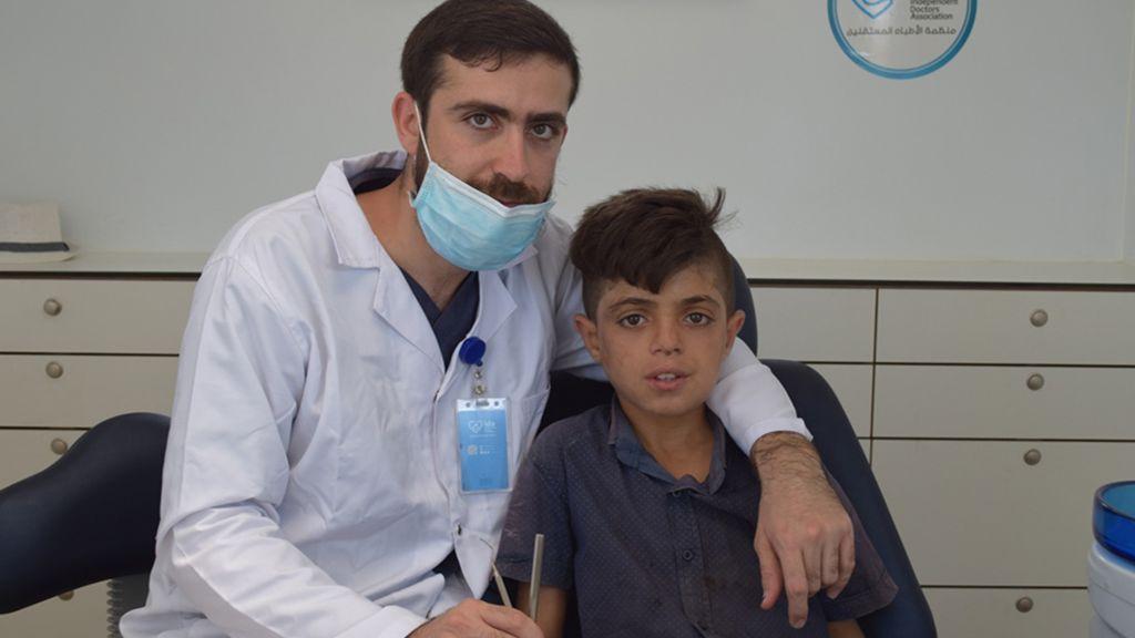 Zahnarzt mit einem Patienten